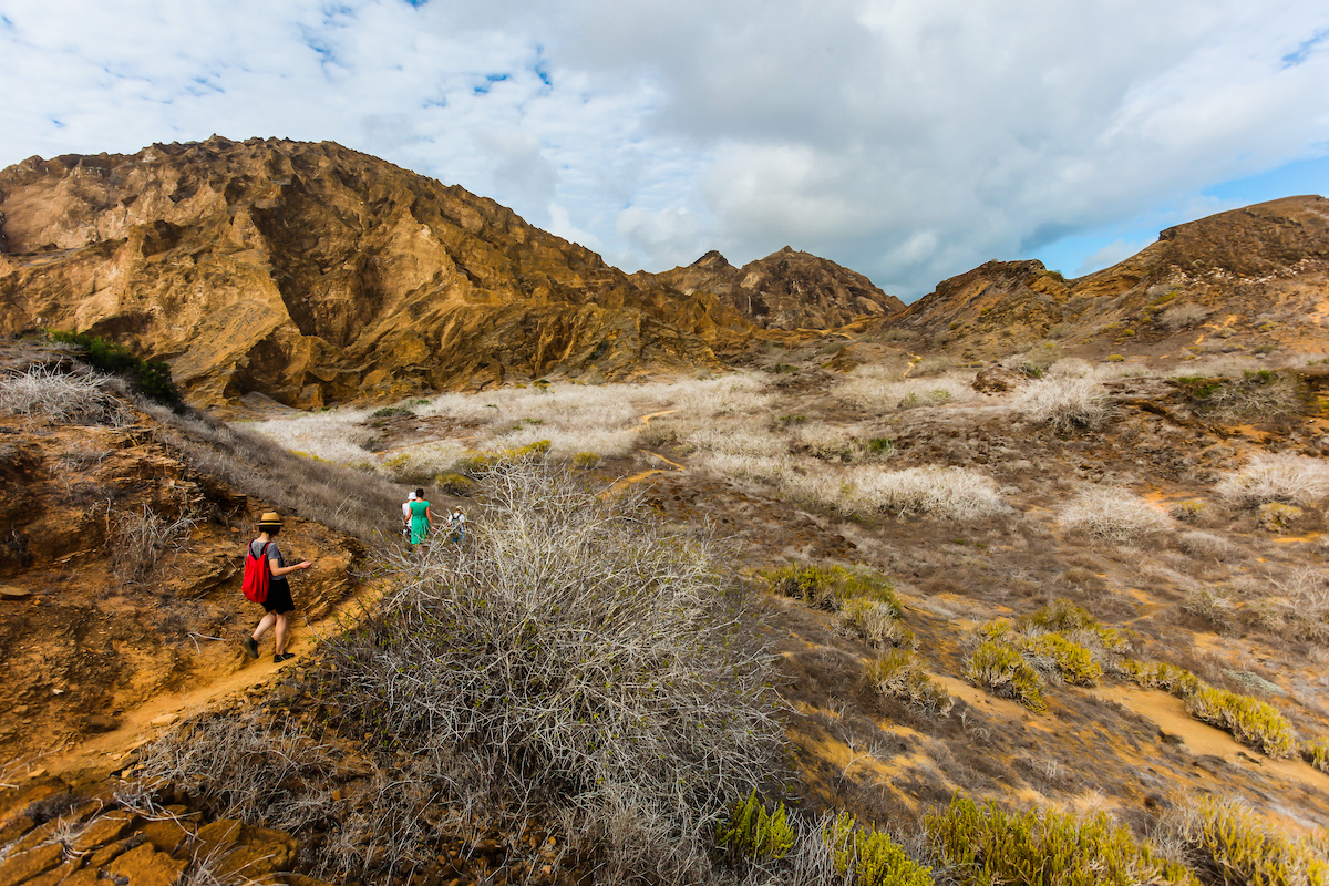 Tourists on the trails at the top of Punta Pitt, Galapagos